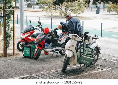 Portugal, Lisbon 29 april 2018: workers Uber Eats delivery scooter with pannier
