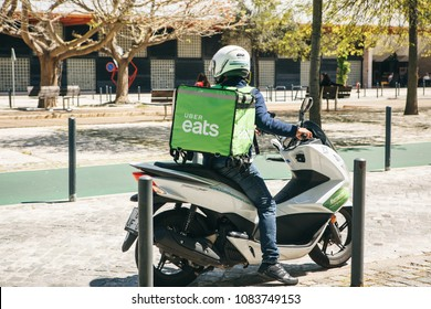Portugal, Lisbon 29 april 2018: worker Uber Eats on the scooter delivers food to customers.