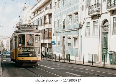 Portugal, Lisbon, June 01, 2018: A traditional yellow old-fashioned tram ride down the city street.