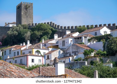 Portugal, Obidos. Ancient city wall, medieval structure encircles historic Obidos.