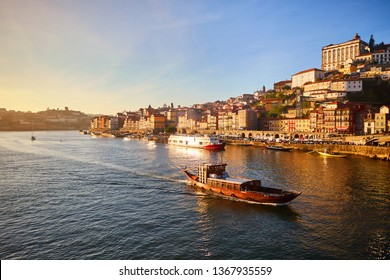 Portugal, Porto old town ribeira aerial promenade view with colorful houses, Douro river and boats.Concept of world travel, sightseeing and tourism