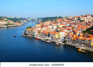 Portugal, Porto, view of the city and Douro's river early in the morning - tilt shift effect
