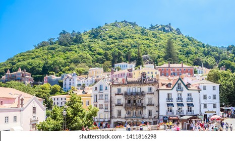 Portugal, Sintra, July 16, 2018: Old town of Sintra with view to the Moorish Castle atop the surrounding hills, Sintra, Portugal,
