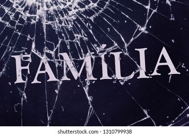 """The Portugal text """"Family"""" on the broken glass. Conflict or loneliness concept."""