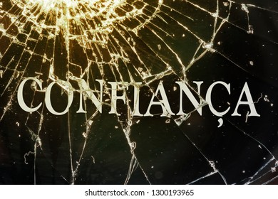 """The Portugal text """"Trust"""" on the broken glass. The deceived trust concept."""