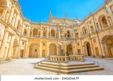 Portugal, Tomar. Bottom view of claustro de D. Joao III, courtyard with fountain of Convent of Christ in Templar Castle. Unesco Heritage and popular destination in Europe.