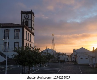 Portugal, VILA FRANCA DO CAMPO, Sao Miguel, Azores, December 20, 2018: Building of Town Hall with clock tower in colonial style and christmas decoration at square in the center of Vila Franca do Campo