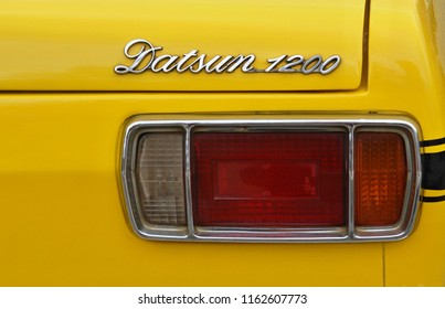 Portugal,Algarve,Loule 09.02.2016 Taillight of a yellow 70's Datsun 1200