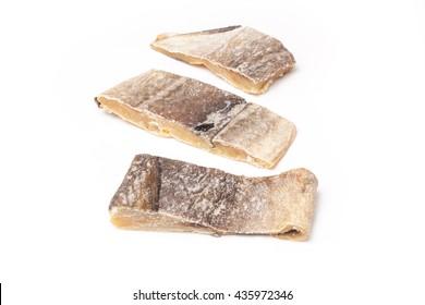 Portugese Bacalhau ,salted codfish or salt cod isolated on a white studio background