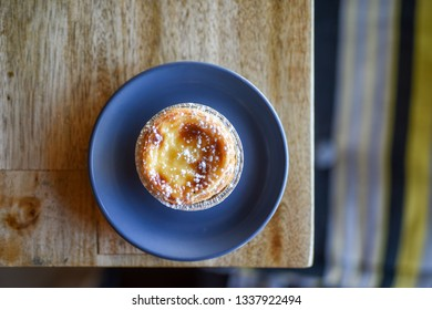 Portugese Tart on Wooden Table