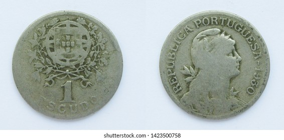 Portuguese 1 Escudo copper-nickel coin 1930 year, Portugal. The coin shows a Coat of Arms of Portugal and woman's head with her hair down in phrygian cap, crowned with laurel, personifying a Republic.