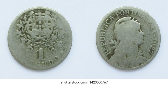 Portuguese 1 Escudo copper-nickel coin 1927 year, Portugal. The coin shows a Coat of Arms of Portugal and woman's head with her hair down in phrygian cap, crowned with laurel, personifying a Republic.