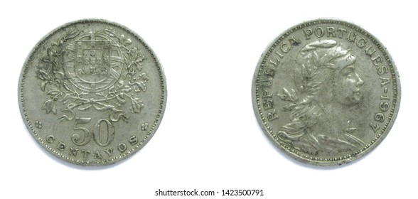 Portuguese 50 Centavos copper-nickel coin 1967 year. The coin shows a Coat of Arms of Portugal and woman's head with her hair down in phrygian cap, crowned with laurel, personifying a Republic.