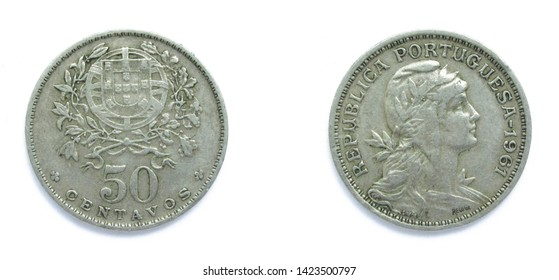 Portuguese 50 Centavos copper-nickel coin 1961 year. The coin shows a Coat of Arms of Portugal and woman's head with her hair down in phrygian cap, crowned with laurel, personifying a Republic.
