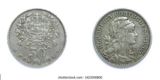 Portuguese 50 Centavos copper-nickel coin 1964 year. The coin shows a Coat of Arms of Portugal and woman's head with her hair down in phrygian cap, crowned with laurel, personifying a Republic.