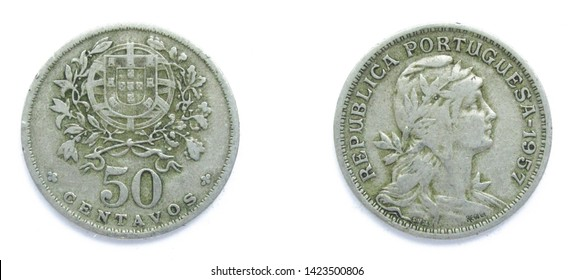 Portuguese 50 Centavos copper-nickel coin 1957 year. The coin shows a Coat of Arms of Portugal and woman's head with her hair down in phrygian cap, crowned with laurel, personifying a Republic.