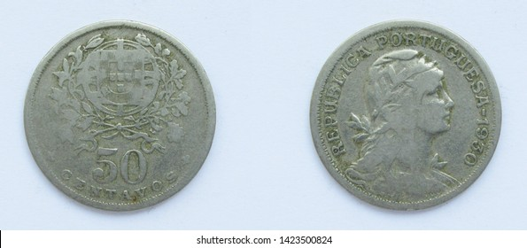 Portuguese 50 Centavos copper-nickel coin 1930 year. The coin shows a Coat of Arms of Portugal and woman's head with her hair down in phrygian cap, crowned with laurel, personifying a Republic.