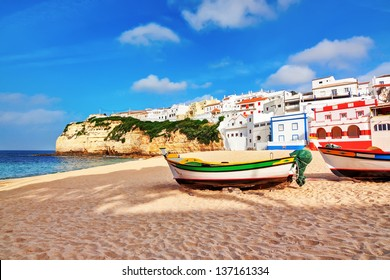 Portuguese beach villa in Carvoeiro classic fishing boats. Summer.