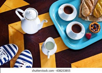 Portuguese breakfast. Room service in hotel in Portugal. Black coffee, pasteis de nata, strawberries.