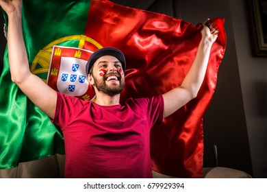 Portuguese fan holding the national flag.