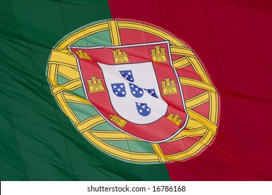 a portuguese flag blowing with the wind