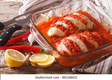 Portuguese food: spicy chicken piri piri close up in baking dish. horizontal