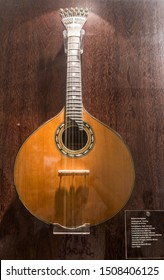 Portuguese guitar, Museo do Fado (Museum of Fado), Lisbon, Portugal. September 2019. Beautiful plucked string instrument with twelve steel strings. Iconically associated with fado.