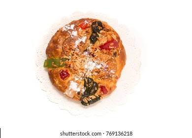 Portuguese King Cake is a famous christmas celebration cake with dry nuts and crystalized fruits.