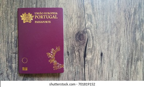 Portuguese passport on wooden background
