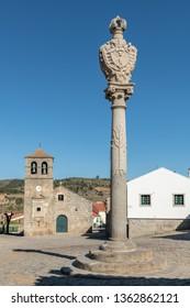 Portuguese Pillory and Church and bell tower from the 17th century at Freixo do Numao. Council of Vila Nova de Foz Coa. Portugal. Douro Region.