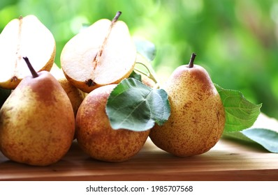 portuguese rocha pears and leaves on table