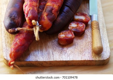 portuguese sausage chourico and knife on table