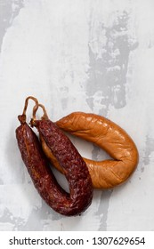 portuguese smoked sausages on ceramic background