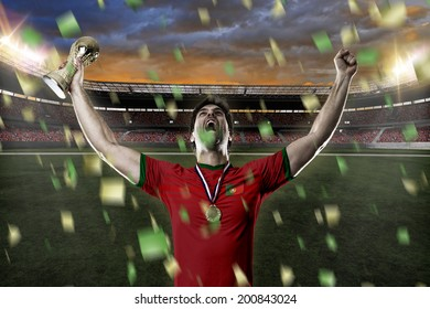 Portuguese soccer player, celebrating the championship with a trophy in his hand. On a stadium.