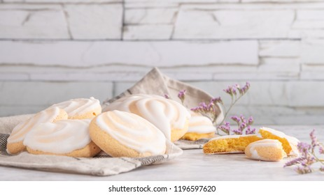 Portuguese sweets cavacas on napkin in a table. Typical cookies with sugar