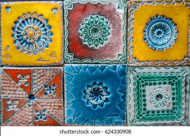 Portuguese tiles pattern with blue, yellow and red ornaments - azulejos, mexican talavera, italian majolica or spanish motifs, wall siding print for ceramic porcelain wall, flowery patterns, mandalas