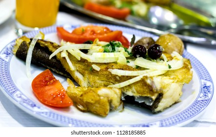 Portuguese typical dish - cod fish with vegetables and olive oil. Simple diet known for it's health virtues. Served in the small typical cafe in Lisbon.