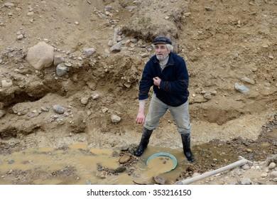 PORVENIR, CHILE - NOVEMBER 12,2014: Miner washing gold in Tierra del Fuego.