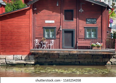 Porvoo, FINLAND - AUGUST 20, 2017: Porvoo river and it's scenic row of old rust-red warehouses