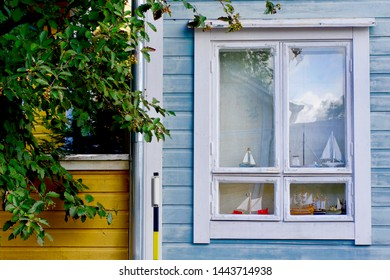 PORVOO, FINLAND - AUGUST 27, 2018: Boats decorate the window of an old wooden home on August 27, 2018 in Porvoo (Borgå), Finland. This medieval town near Helsinki is the second oldest city in Finland.