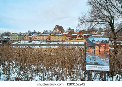 Porvoo, Finland - December 25, 2018: Old historic Porvoo, Finland with wooden houses and medieval stone and brick Porvoo Cathedral at blue hour sunrise.