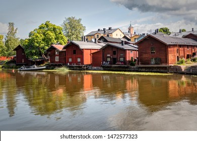 Porvoo, Finland - July 14, 2019 - Embankment of the city of Porvoo. Postcard view of the city. Old red barns on the embankment of the Porvoonjoki River. Symbol of Old Porvoo.