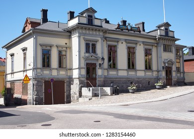 PORVOO, FINLAND - JULY 16, 2017: People at the building of Porvoo Volunteer Fire Brigade. The corps was founded in 1867 and its name was then the Voluntary Fire Brigade in Porvoo city