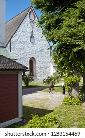 PORVOO, FINLAND - JULY 16, 2017: People at Porvoo cathedral. It was built in the 15th century, although the oldest parts date from the 13th century
