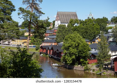 PORVOO, FINLAND - JULY 16, 2017: View to the river Porvoonjoki and Porvoo cathedral. The red-colored wooden storage buildings on the riverside are a proposed UNESCO world heritage site