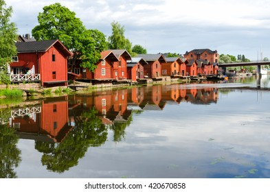 PORVOO, FINLAND - JULY 20, 2015: Old wooden houses reflected in the river.