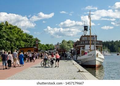 Porvoo, Finland - July 20. 2019 -  Passengers getting on board the historic wooden cruise boat m/s J.L. Runeberg (built 1912) sailing between Porvoo and Helsinki