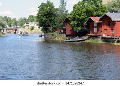 Porvoo, Finland - July 28, 2019: River Porvoo (Porvoonjoki in Finnish) and old wooden red houses on the riverside.