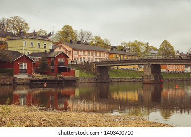 Porvoo, Finland - may 2019: cobbled streets of the medieval village of Porvoo. Porvoo river and it's scenic row of old rust-red warehouses facing the calm water with reflections
