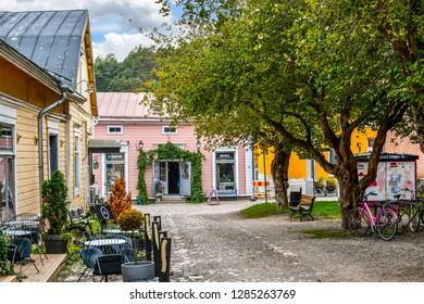 Porvoo, Finland - September 10 2018: Shops surround a small square and park in the medieval city of Porvoo, Finland.